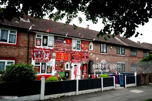 A house in Liverpool close to the famous Anfield stadium is decorated in Liverpool FC memorabilia to celebrate after Liverpool FC ended a thirty year...