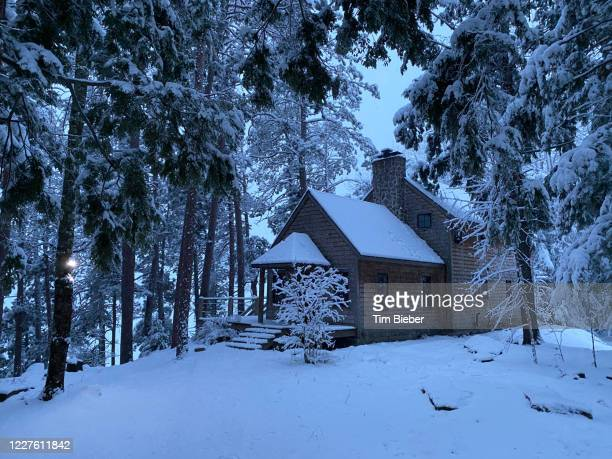 house in snow - upper peninsula stock pictures, royalty-free photos & images