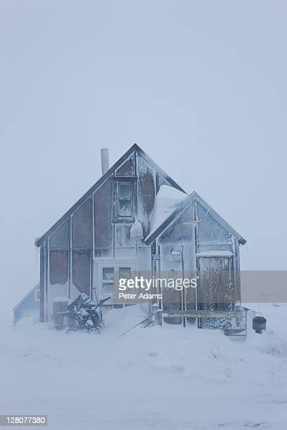 house in snow, tasiilaq, e. greenland - peter adams stock pictures, royalty-free photos & images