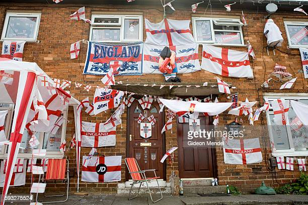 A house in StokeonTrent which has become a local landmark due to the chaotic profusion of England flags of all shapes and sizes which are hanging on...