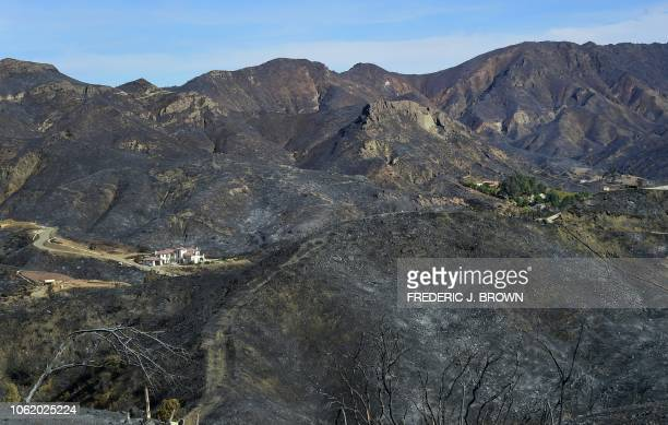 A house in the distance was left unscathed from the Woolsey Fire despite its fireravaged and charred mountainous surroundings as seen from a...