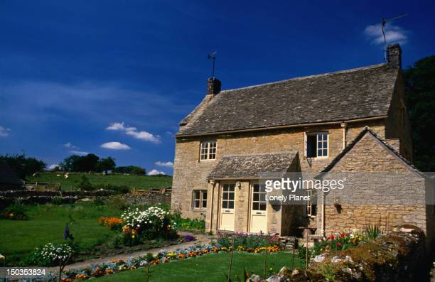 A house in Upper Slaughter in the Cotswolds on a summers day - England