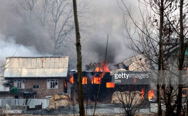 A house in which militants are suspected to have sheltered is in flames after a gunfight happened between rebels and Indian security forces that...
