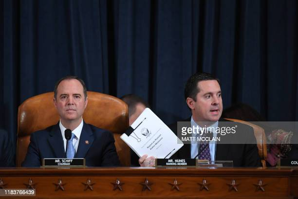 House Intelligence Committee chair Adam Schiff looks on as Ranking Member Devin Nunes submits a report on the Russian interference in the 2016...
