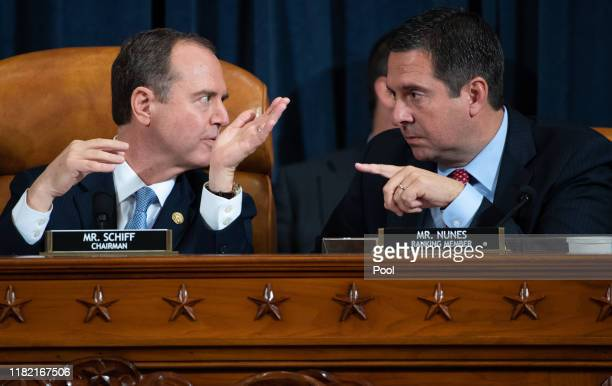 House Intelligence Committee Chairman Adam Schiff and ranking member of the House Intelligence Committee Devin Nunes talk during the first public...