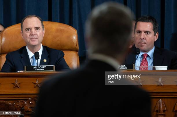House Intelligence Committee Chairman Adam Schiff and ranking member of the House Intelligence Committee Devin Nunes watch as witness William B...
