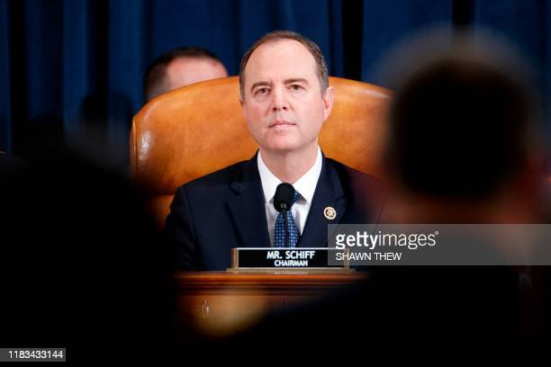 House Intelligence Committee Chairman Adam Schiff DCA gives his opening remarks as Jennifer Williams an aide to Vice President Mike Pence and...