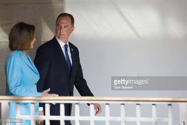 House Intelligence Committee Chairman Adam Schiff walks beside House Speaker Nancy Pelosi ahead of a weekly news conference on October 2 on Capitol...