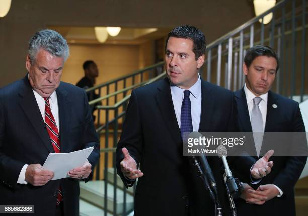 House Intelligence Committee Chairman Devin Nunes stands with Rep Peter King and Rep Don DeSantis as he announces that his committee and the House...