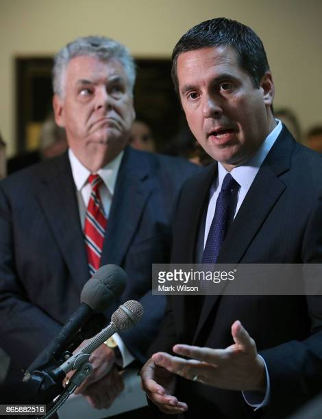 House Intelligence Committee Chairman Devin Nunes while flanked by Rep Peter King as he announces that his committee and the House oversight...
