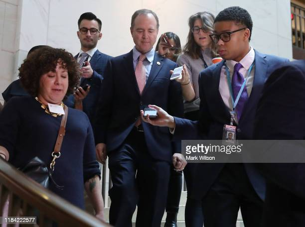 S House Intelligence Committee Chairman Rep Adam Schiff is trailed by reporters as he walks to a closeddoor deposition on Capitol Hill October 29...