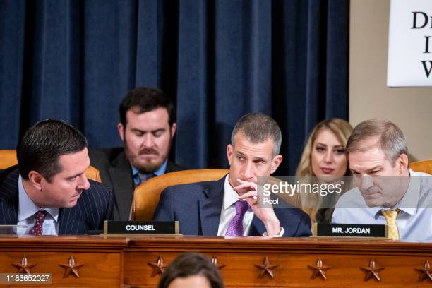 House Intelligence Committee Ranking Member Devin Nunes minority counsel Steve Castor and Rep Jim Jordan confer during testimony by Gordon Sondland...
