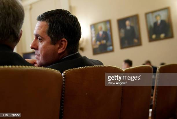 House Intelligence Committee ranking member Rep Devin Nunes speaks with Rep Mark Meadow as constitutional scholars testify before the House Judiciary...