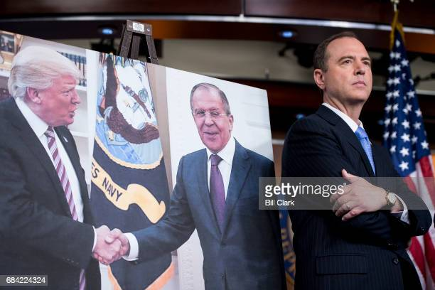 House Intelligence ranking member Adam Schiff DCalif stands next to a photo of President Donald Trump in the Oval Office shaking hands with Russian...