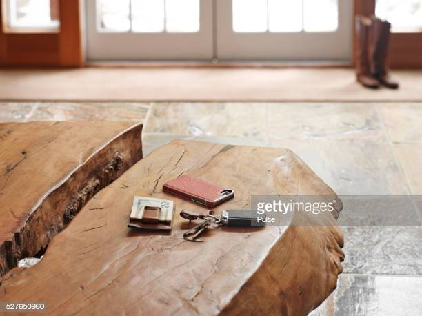 House interior with alarm device, cell phone and US currency on table