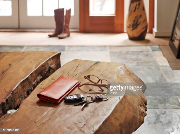 House interior with alarm device, glasses and wallet on table