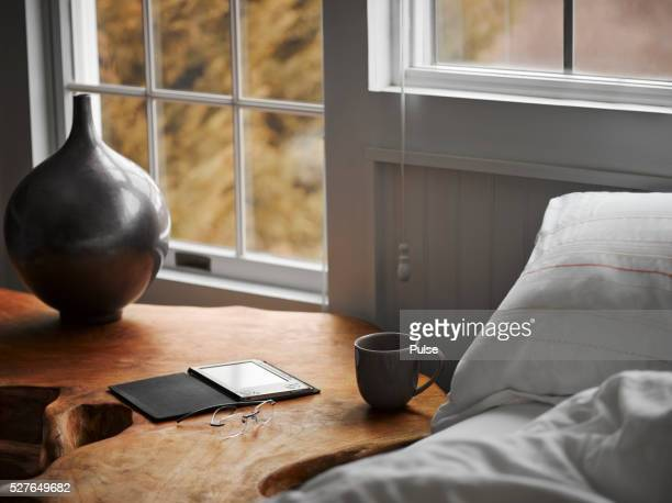 House interior with digital tablet on night table