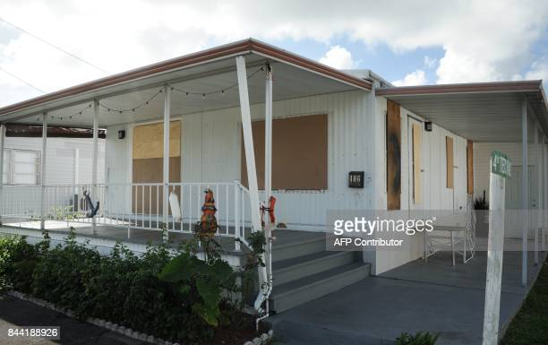 A house is boarded up at the Sea Esta mobil home park during preparations for Hurricane Irma in Hallandale Florida on September 8 2017 Florida...