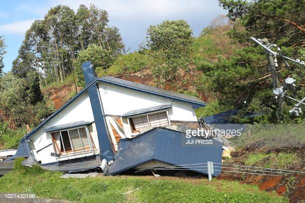 A house is damaged by landslides caused by an earthquake in Atsuma town Hokkaido prefecture on September 6 2018 A powerful 66magnitude quake rocked...