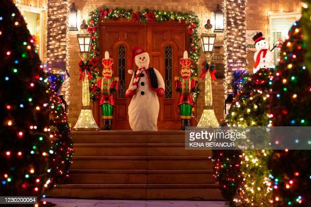House is decorated decorated for Christmas in the Brooklyn neighborhood of Dyker Heights on December 15 in New York City. - In a New York where...