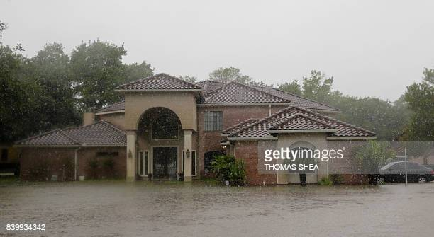 A house is flooded in east Pearland on August 27 2017 as the US fourth city city battles with tropical storm Harvey and resulting floods / AFP PHOTO...