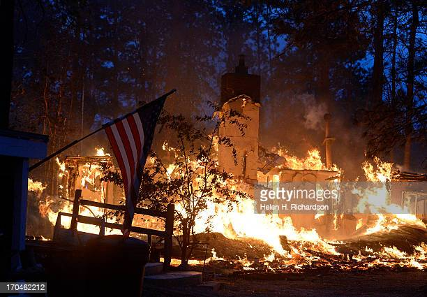 A house is fully engulfed with flames in the midst of the Black Forest Fire northeast of Colorado Springs on June 12 2013 Photo by Helen H...