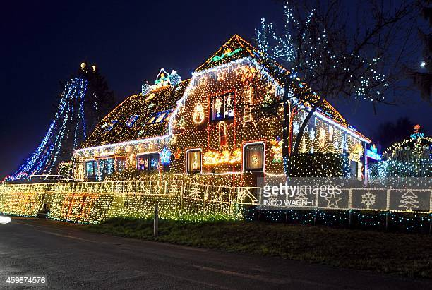 A house is illuminated with more than 400000 lights in Calle central Germany on November 26 2014 The house's owner started 1999 decorating his house...