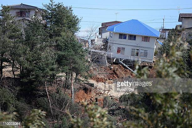 House is left damaged by landslides after an 8.9 magnitude strong earthquake struck on March 11 off the coast of north-eastern Japan, on March 12,...