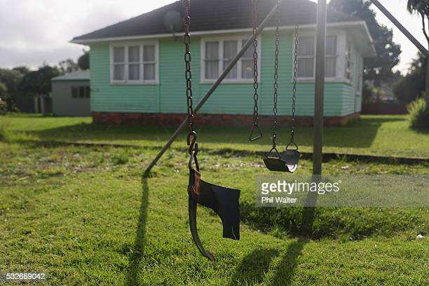 A house is pictured alongside a run down playground on May 19 2016 in Auckland New Zealand The budget due to be announced by Bill English on May 26...