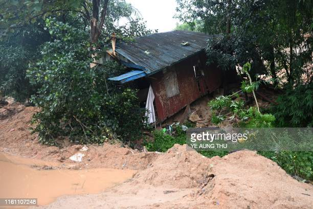 TOPSHOT A house is seen damaged after a landslide in Mutkyi village in Paung township Mon state on August 12 2019 A fatal landslide on August 9 in...