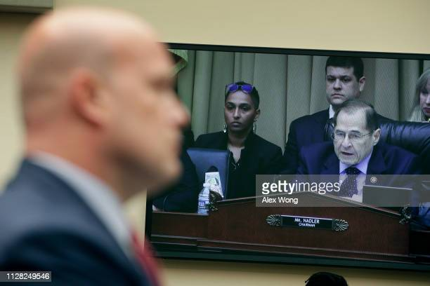 House Judiciary Committee Chairman Jerrold Nadler appears on a television screen while delivering opening remarks during a hearing with acting US...