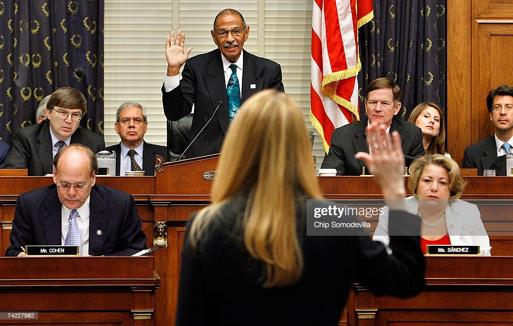 House Judiciary Committee Chairman John Conyers (D-MI) (top C) swears in Monica Goodling, former Justice Department White House liaison, before she testifies to the committee on Capitol Hill May 23, 2007 in Washington, DC. Goodling, who resigned last month, will testify about the 2006 firing of eight US attorneys by the Justice Department only after securing immunity from prosecution. Many lawmakers on both sides of the asile have called for Attorney General Alberto Gonzales to be fired over the attorneys' dismissal.