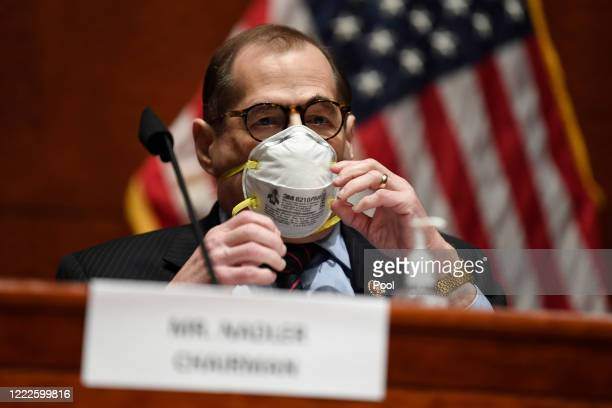 House Judiciary Committee Chairman Rep Jerrold Nadler adjusts his face mask during a hearing on oversight of the Justice Department and a probe into...