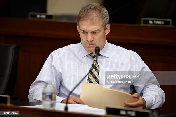 House Judiciary Committee member Rep Jim Jordan prepares for a hearing with Internal Revenue Service Commissioner John Koskinen in the Rayburn House...
