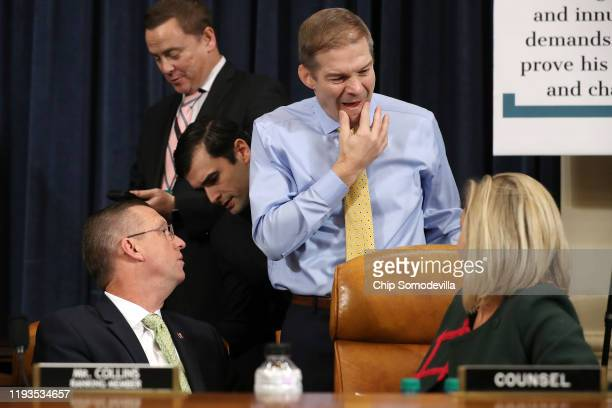 House Judiciary Committee member Rep Jim Jordan talks with ranking member Rep Doug Collins and minority counsel Ashley Hury Callen during a committee...