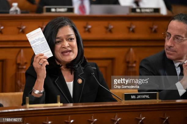 House Judiciary Committee member Rep. Pramila Jayapal holds a copy of the U.S. Constitution while giving an opening statement during a committee...