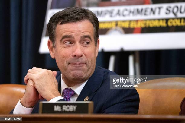 S House Judiciary Committee members Rep John Ratcliffe listens to opening statements during a markup hearing on the articles of impeachment against...