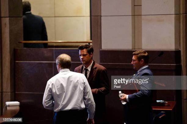 S House Judiciary Committee Ranking Member Jim Jordan and Reps Matt Gaetz and Guy Reschenthaler talk during a hearing at the Capitol Building June 24...