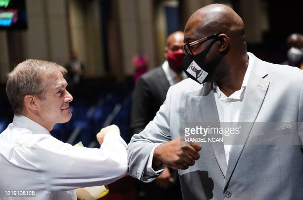 House Judiciary committee Ranking Member Jim Jordan ROH taps elbows with Philonise Floyd brother of George Floyd after the House Judiciary committee...