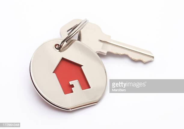 house key and keychain - house key stock photos and pictures