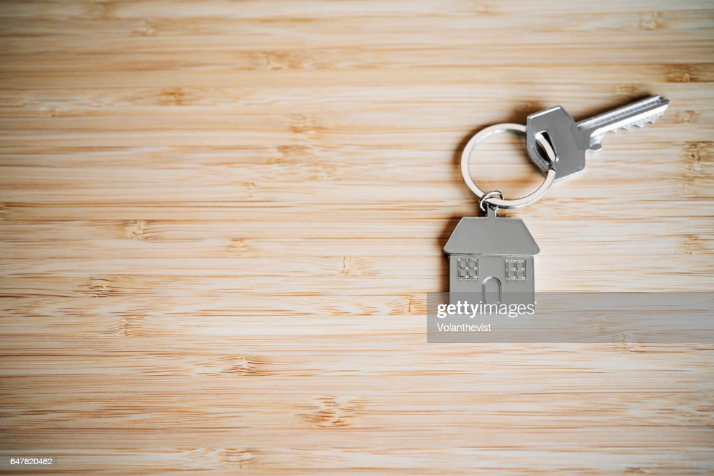 House key on a bamboo table with copy space : Stock Photo