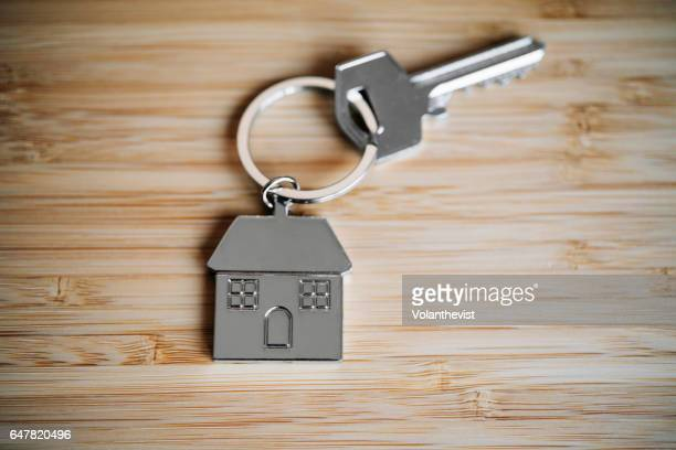 house key on a bamboo table with copy space - house key stock photos and pictures