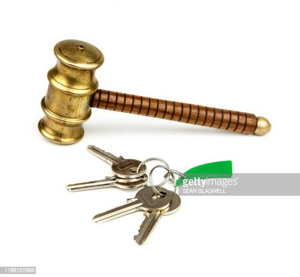 house keys and auction hammer - bid stock pictures, royalty-free photos & images
