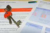 House keys on a bank letter informing customer of Mortgage Arrears and repossession  with bank statement