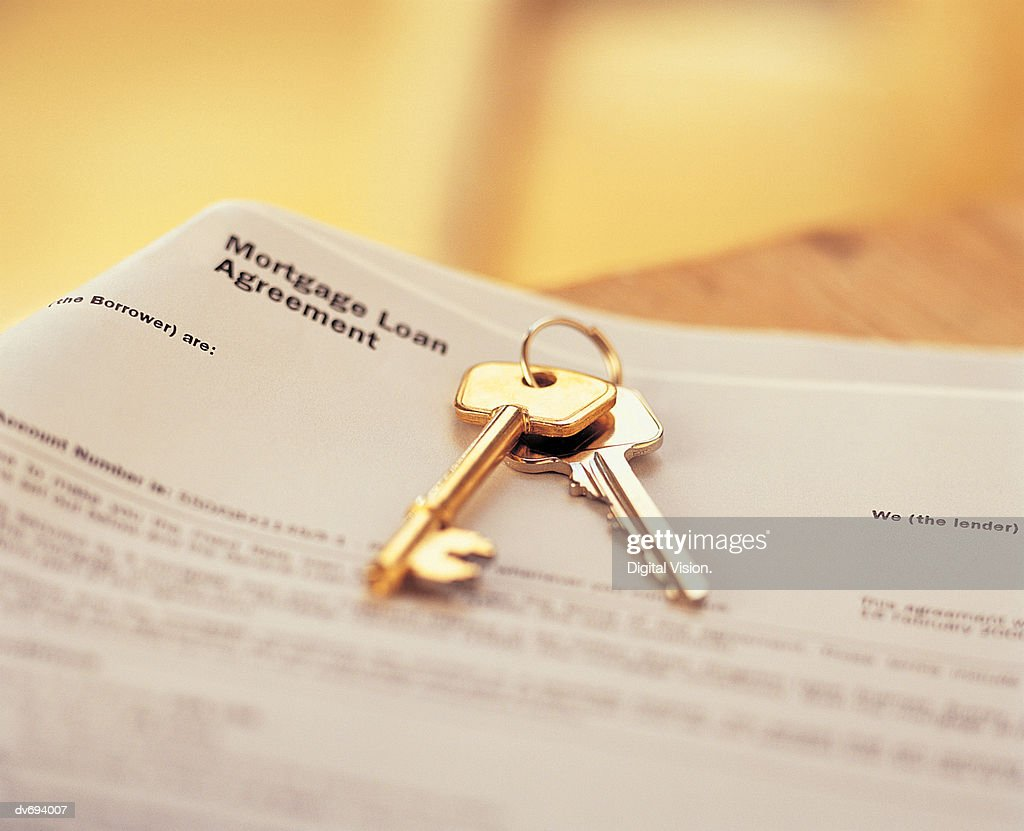 House Keys On Mortgage Agreement : Stock Photo