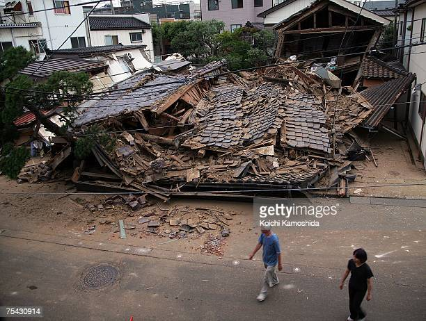 A house lays flattened by the magnitude 68 earthquake on July 17 2007 in Kashiwazaki Niigata Prefecture Japan Five people have died and more than 680...
