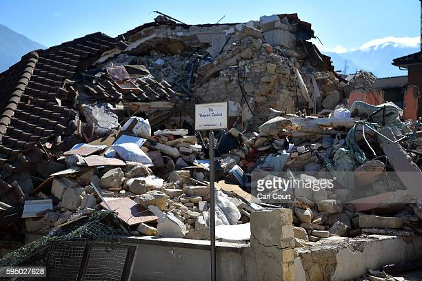A house lies destroyed after being hit by an earthquake on August 25 2016 in Amatrice Italy The death toll in the 62 magnitude earthquake that struck...