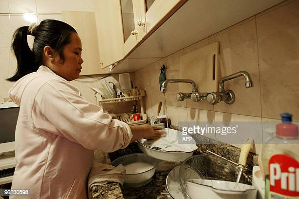 MOUSSAOUI A house maid from Philippines washes the dishes at her employers' apartment in the Lebanese capital Beirut on January 12 2010 Lebanon's...