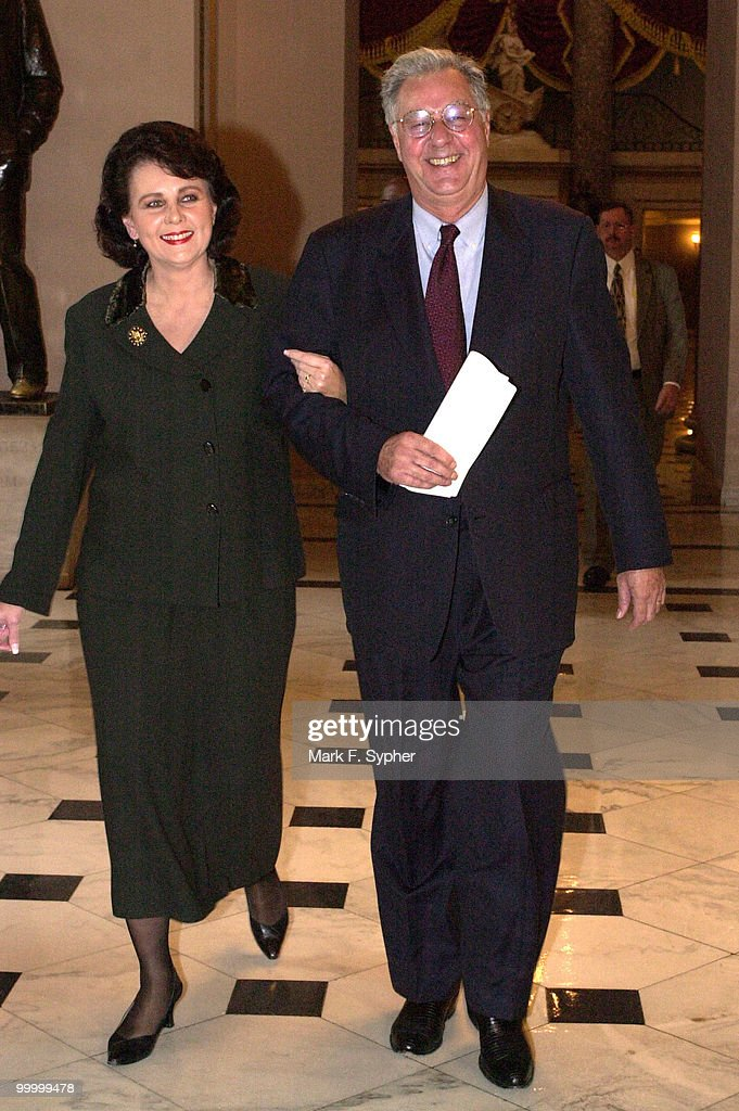 House Majority Leader, Dick Armey walks with his wife, Susan, into the House Chamber before announceing his retirement on Wednesday.
