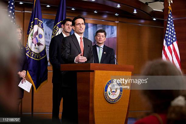 House Majority Leader Eric Cantor a Republican from Virginia center speaks while Representatives Paul Ryan a Republican from Wisconsin left and Jeb...